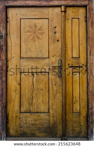 Historical Ornate Wooden Door in a Stone Entry, Prague, The Czech Republic