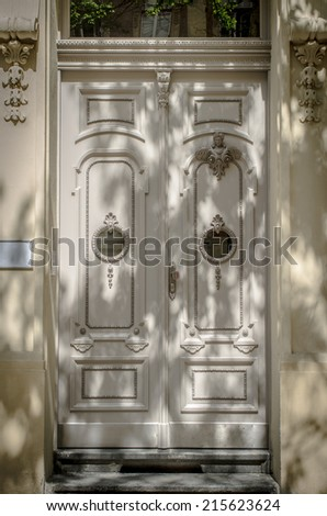Historical Ornate Wooden Door in a Stone Entry with Pillars, Prague, The Czech Republic - stock photo