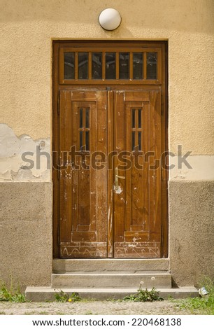 Historical Ornate Wooden Door with Glass Panes in a Stone Entry, Prague, The Czech Republic - stock photo