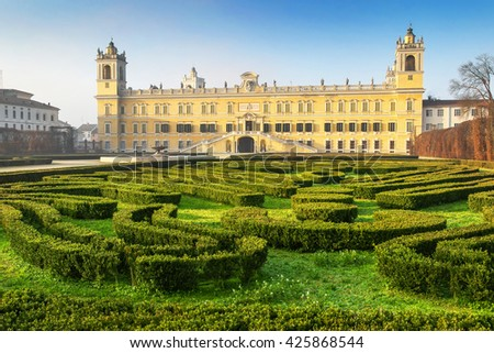 Historical palace of Reggia di Colorno and green labyrinth in sunny day, Colorno, Emila Romagna region, Italy. - stock photo