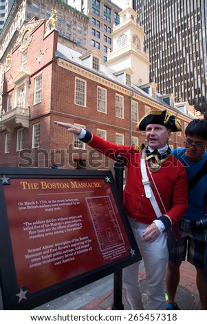 Historical reenactor-docent at site of March 5, 1770 Boston Massacre, pre-American Revolution and Old South Meeting House, Freedom Trail, Boston, MA  - stock photo
