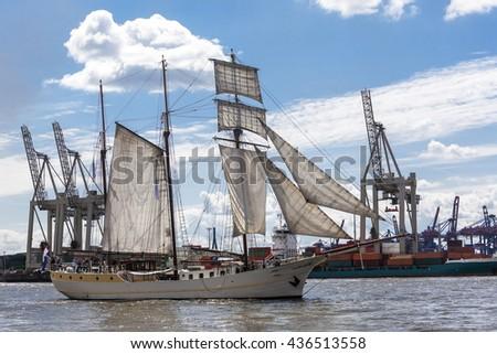 Historical Sailing Ship, passing Pontoon Jetties Neumuehlen, Harbor of Hamburg, Germany - stock photo
