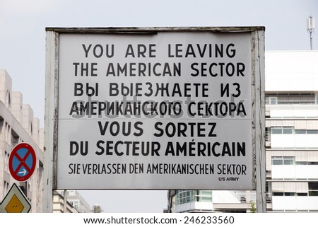 Historical sign at the former Checkpoint Charlie border crossing in Berlin, German - stock photo