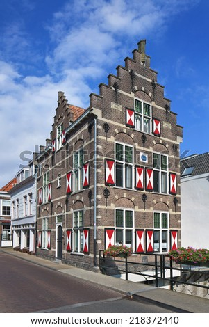 Historical stately mansion with red and white shutters, Gorinchem, The Netherlands - stock photo