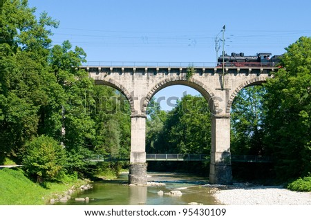 Historical steam engine train on the so called viadukt an Traunstein in Bavaria - stock photo