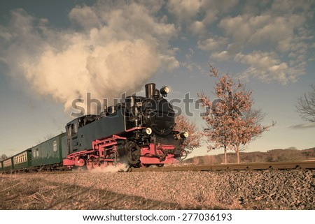 Historical steam train on island Rugen in Germany, toned image