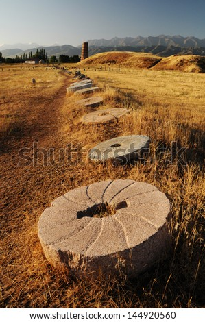 Historical stone sculptures and Old Burana tower located on famous Silk road, Kyrgyzstan - stock photo
