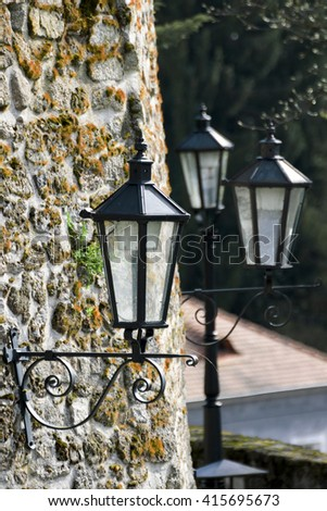 Historical street lamp on the stone wall