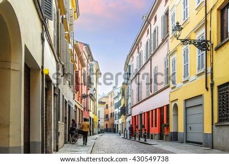 Historical street with colorful residential houses in Parma, Emilia-Romagna province, Italy. - stock photo