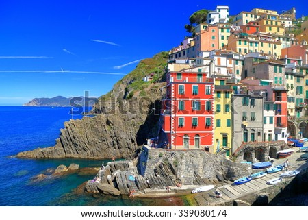 Historical tower houses above the sea near the harbor of Riomaggiore, Cinque Terre, Italy