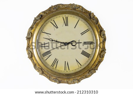 Historical watches with old clock face and golden frame - stock photo