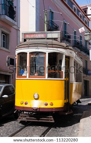 Historical yellow tram in Lisbon, Portugal - stock photo