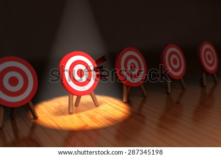 Hit the target concept, successful business strategy and targeting, one highlighted target with arrows hitting the center - stock photo