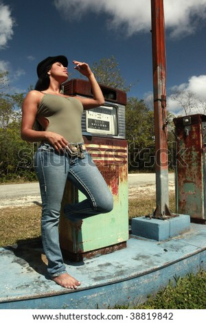 Hitchhiker and a vintage gas pump - stock photo