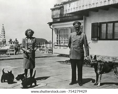 Hitler and Ava Braun with their dogs at Berchtesgaden, ca. 1937-1943. Braun and Hitler remained a couple for 13 years, from 1932-1945.