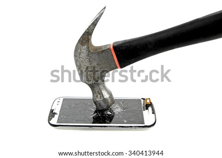 Hitting with hammer to phone screen on white background - stock photo
