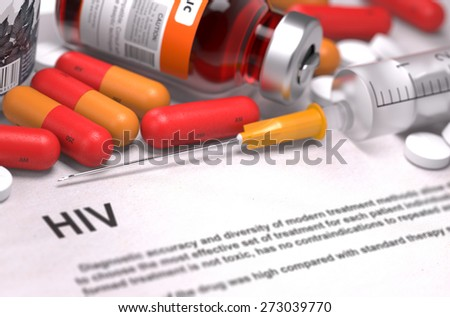 HIV - Printed Diagnosis with Blurred Text. On Background of Medicaments Composition - Red Pills, Injections and Syringe. - stock photo