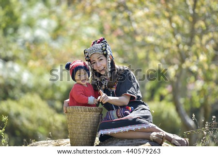 Hmong girl with daughter.