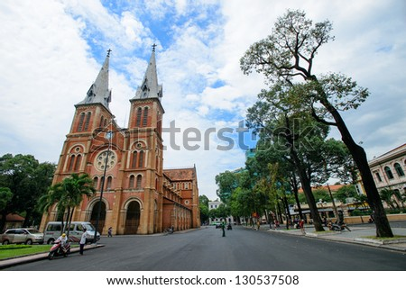 HO CHI MINH CITY - FEB 23 : View of Notre Dame Cathedral from the street in Ho Chi minh City, Vietnam on February 23, 2013. Notre Dame Cathedral is set in the heart of HCMC�s government quarter. - stock photo