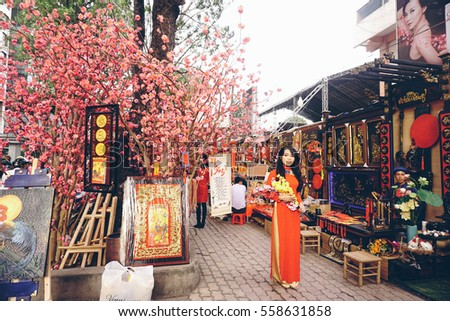 Ho Chi Minh city, 16 Jan 2017 - Dong Khoi ttreet was decorated by various kind of flowers such as peach flower, yellow apricot in Tet holidays, Ho Chi Minh, Vietnam. Vietnam Lunar New Year in spring