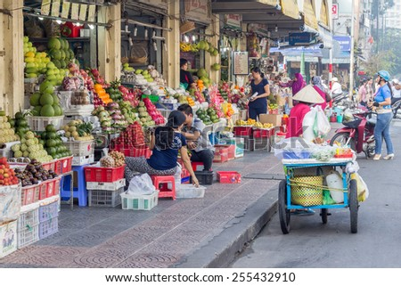 Ho Chi Minh City-Nov 1st 2013: Fruit shops outside Ben Thanh market. Ben Thanh is the main market in thr city. - stock photo