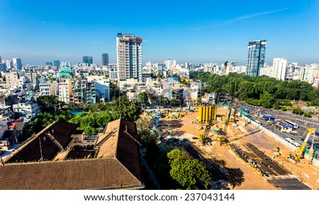 HO CHI MINH CITY (SAIGON), VIETNAM - NOVEMBER 6, 2014 - A construction site outside Ben Thanh market.The construction site for a new modern metro terminal to be built in front of Ben Thanh market. - stock photo