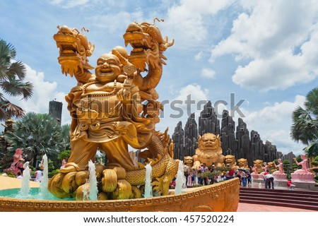 Ho Chi Minh city ( Saigon ), Vietnam - September 02, 2015: Fountain with gold dragon and buddha statues in water park and historical theme amusement park Suoi Tien - best south Vietnam cultural park. - stock photo