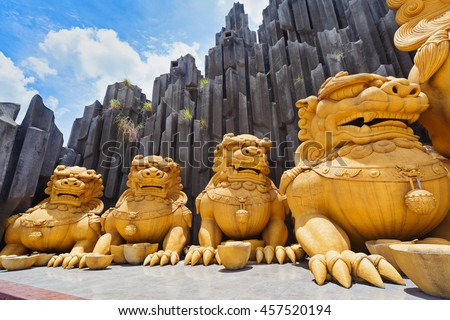 Ho Chi Minh city ( Saigon ), Vietnam - September 02, 2015: gold dragons statues in children water park and historical theme amusement park Suoi Tien - popular travel destination in south Vietnam . - stock photo