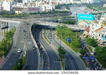 HO CHI MINH CITY, VIET NAM- AUG 11: Development of infrastructure with overpass road at intersection, number of vehicle as motorbike develop very strong, traffic overloaded, Vietnam, Aug 11, 2014