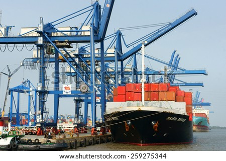 HO CHI MINH CITY, VIET NAM- FEB11: Transportation for export, import at Cat Lai port on Sai Gon river, crane load container to boat, this harbor is big industry service for trade, Vietnam, Feb 11,2015