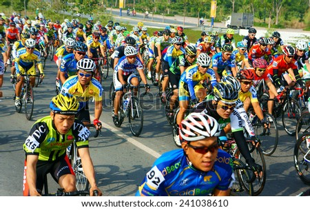 HO CHI MINH CITY, VIET NAM- JAN2: Amazing cycle race, sport activity to happy new year at Asia, rider wear helmet, ride bicycle in high speed, spirit, Vietnamese rider in action, Vietnam, Jan 2, 2014
