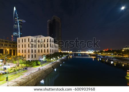 HO CHI MINH CITY, VIET NAM - MARCH 15, 2017: Ho Chi Minh city at night, view from Cau Mong Bridge to Sai Gon river.