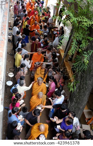 HO CHI MINH CITY, VIET NAM- MAY 21, 2016: Religion activity at Buddhist temple on Buddha's birthday celebration, group of Asia monks walk to beg for alms, traditional culture of Buddhism, Vietnam