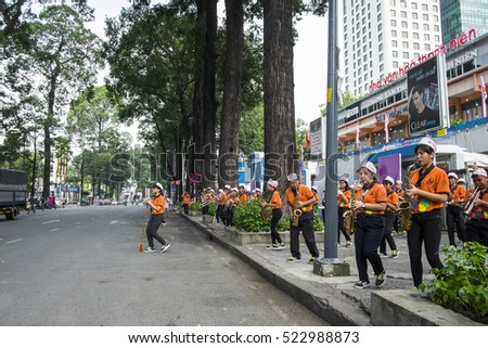 HO CHI MINH CITY, VIET NAM - NOV 26, 2016: A young pupil/student band playing their concert in front of Nha Van Hoa Thanh Nien, Sai Gon, Viet Nam.