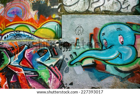 HO CHI MINH CITY, VIET NAM- OCT17: Amazing, beautiful, vivid painting of graffiti art on wall, colorful creative with nice shapes, street art of modern time, Vietnam, Oct 17, 2014