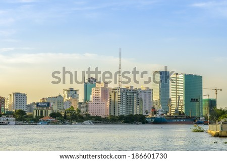 HO CHI MINH CITY, VIETNAM - APR 2: Skyscrapers business center in Ho Chi Minh City, Vietnam, on background of sunset, on Apr 2,2014.   - stock photo