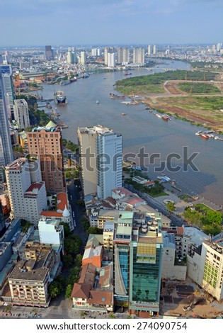 Ho Chi Minh City, Vietnam - April 05, 2015: Panoramic vertical aerial view of the Saigon River, port  and City in the afternoon. - stock photo