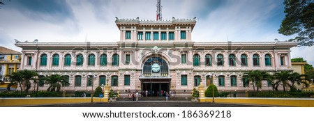 Ho Chi Minh City, Vietnam - April 5 , 2014:People come to visit the central post office in neoclassical architectural style, designed and constructed by the famous architect Gustave Eiffel. - stock photo