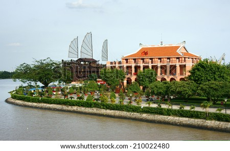 HO CHI MINH CITY, VIETNAM- AUG 10 : Landscape of Nha Rong port under blue sky on day, statue of Ho chi Minh before commemorative house, Vietnamese flag fly, pot of green tree, Viet Nam,  Aug 10, 2014 - stock photo