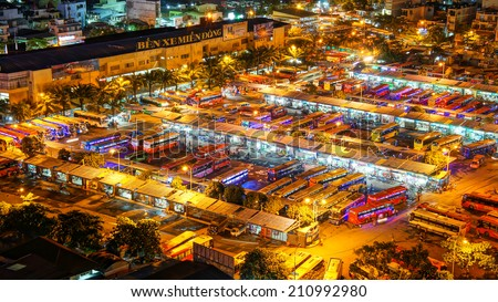 HO CHI MINH CITY, VIETNAM- AUG 14 : Panaromic of Mien Dong bus station at night, group of colorful car wait, this depot has many public passenger transport vehicle at Sai gon, Vietnam, Aug 14, 2014
