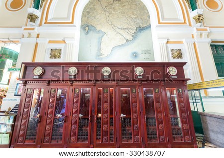 Ho Chi Minh City, Vietnam - August 13, 2015: historic telephone booths, now converted to automatic teller machines, inside the Saigon Central Post Office in Ho Chi Minh City.
