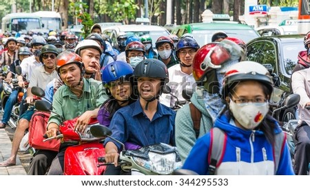 ho chi minh city, vietnam - circa february 2014 - many many scooter drivers on the road