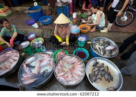 HO CHI MINH CITY, VIETNAM- CIRCA JUNE 2010: Street Vendor in Ho Chi Minh City, Vietnam selling fresh fish on the sidewalk (Ho Chi Minh City, Vietnam - CIRCA June, 2010)