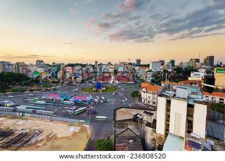 HO CHI MINH CITY, VIETNAM - DEC 9, 2014 - Front side of Ben Thanh market and the surroundings in sunset (HDR). Ben Thanh market is a very famous one in Saigon and located in the center of the city.  - stock photo