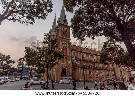 HO CHI MINH CITY,VIETNAM - DEC 29: Tourist and traffic in front of Saigon Notre-Dame Cathedral in Ho Chi minh city,Vietnam on December 29,2015
