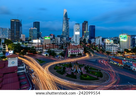 HO CHI MINH CITY, VIETNAM - DECEMBER 05, 2014: Aerial view of Ho Chi Minh city with traffic light trails and modern buildings on background at dusk. Ho Chi Minh city is the biggest city in VN. - stock photo