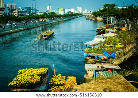 Ho Chi Minh City, Vietnam - Feb 04, 2016: Binh Dong flower floating market along Tau Hu Canal (District 8). Tet Holiday or Vietnamese New Year is the most important celebration in Vietnamese culture.