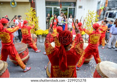 HO CHI MINH CITY, VIETNAM - FEBRUARY 1: A group of unidentified local boys beating their drums during the Tet Lunar New Year celebrations on February 1, 2014 in Ho Chi Minh City, Vietnam. - stock photo