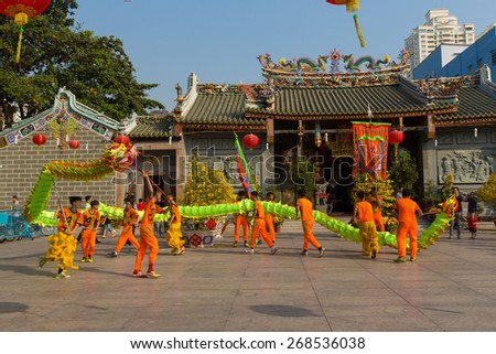 Ho Chi Minh City, Vietnam - February 18, 2015: A show of lion or dragon dance  at Pagoda, China Town, District 5, Cho Lon to praying heathty, safety and lucky during the lunar new year. - stock photo