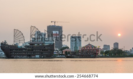 Ho Chi Minh City, VietNam FEBRUARY, 10, 2015: Downtown Saigon in sunset with restauran boats,Ho Chi Minh city, Vietnam. Ho Chi Minh city is the biggest city in Vietnam. - stock photo